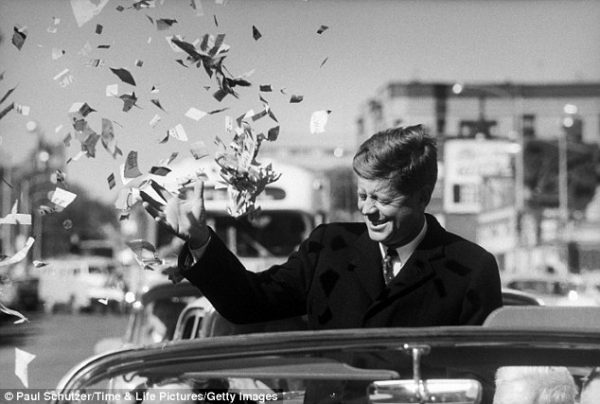 Candidate Kennedy is sprayed with confetti as his motorcade drives through Illinois.
