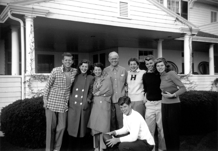 The Kennedy Family in Hyannis Port, 1948. L-R: John F. Kennedy, Jean Kennedy, Rose Kennedy, Joseph P. Kennedy Sr., Patricia Kennedy, Robert F. Kennedy, Eunice Kennedy, and in foreground, Edward M. Kennedy. Photograph in the John F. Kennedy Presidential Library and Museum, Boston.