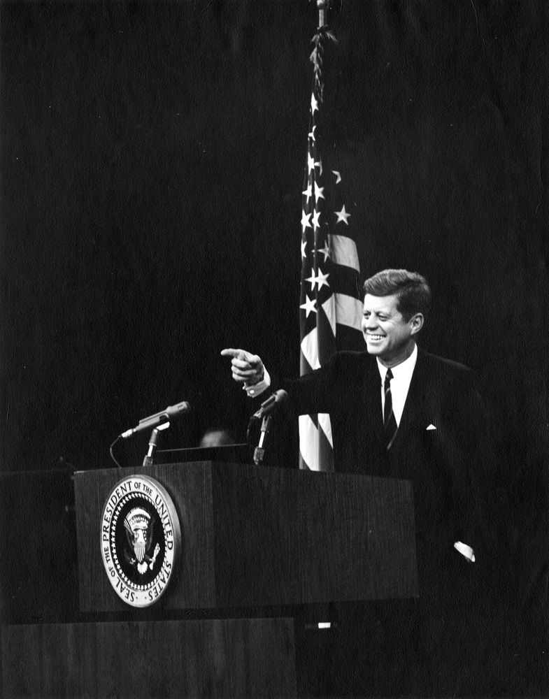 President John F. Kennedy points to a reporter during a press conference. State Department Auditorium, Washington, D.C.