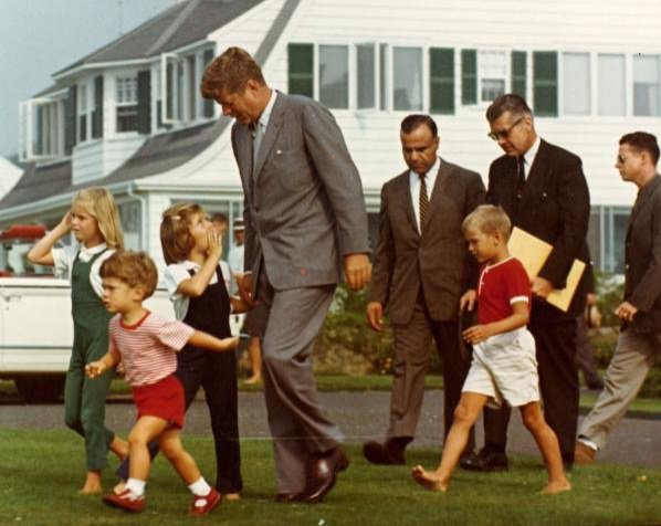 President John F Kennedy Children And Aides Walk Across The Lawn At Compound