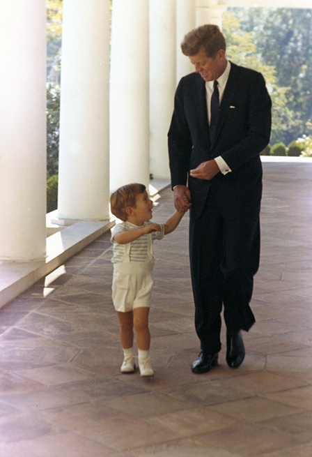 President Kennedy and his son, John F. Kennedy Jr. White House, West Wing Colonnade